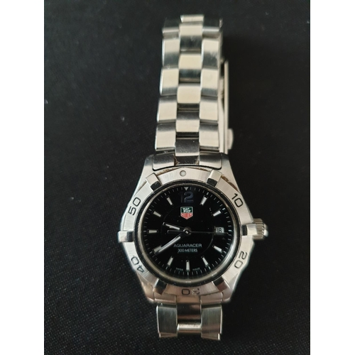 12 - Ladies Tag Heuer watch Aquaracer black faced diving watch  Good up to 1000ft depth...