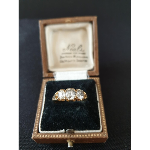25 - 3 diamonds 18ct gold ring Center stone of 0.75 and 2 shoulder stones 0.33 each...