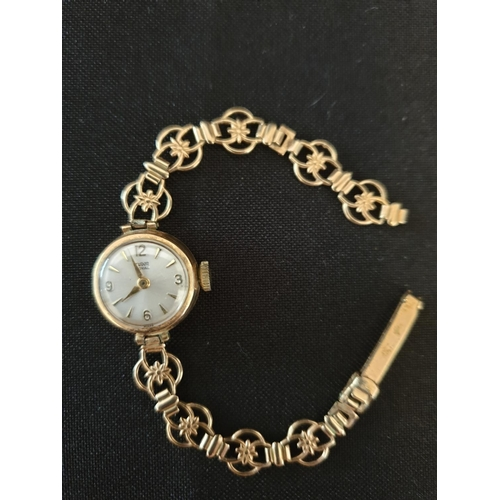 31 - Ladies Tudor watch 1950's elegant 9ct gold watch with floral patterned gold strap...