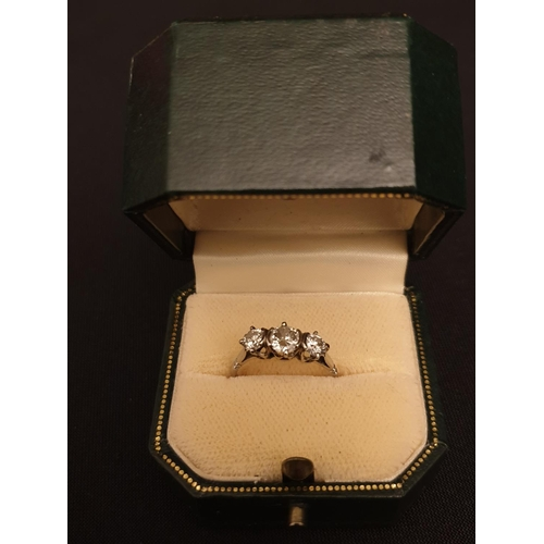 46 - 3-stone diamond ring 18ct white gold with 0.5ct center stone 0.25 shoulder stones...