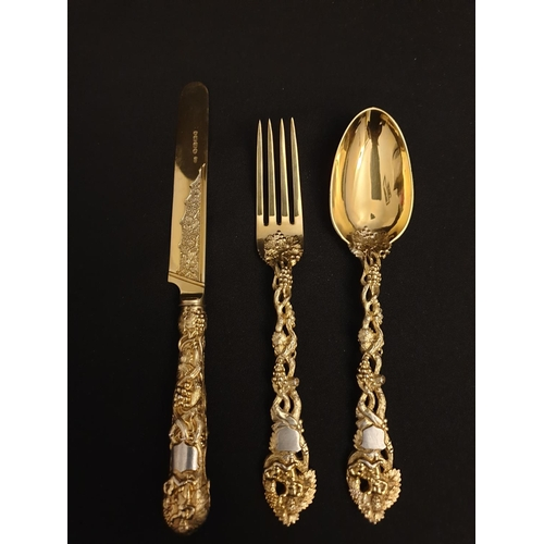 58 - Cutlery set Ornate gold plated silver set of knife, fork and spoon. Made by GEORGE ADAMS 1864...
