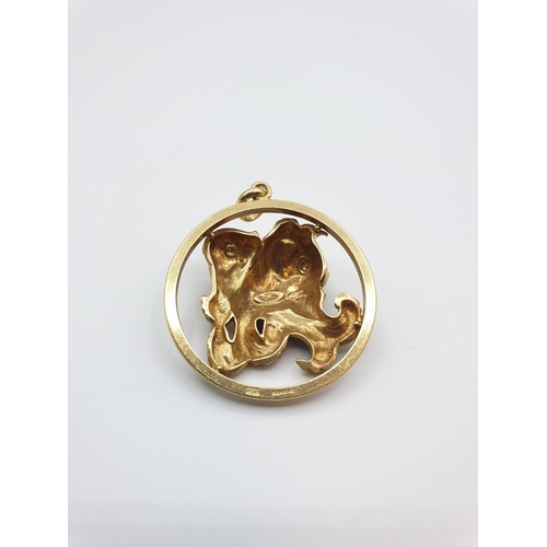 6 - 18ct gold pendant in the form of intertwined Koi Carp representing good fortune ,weight approx 18g....