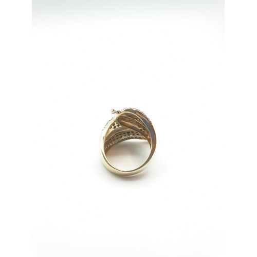 10 - 9CT GOLD 'twist' RING WITH BLACK & WHITE semi precious  and precious Stones  WEIGHT 10G SIZE M/N....
