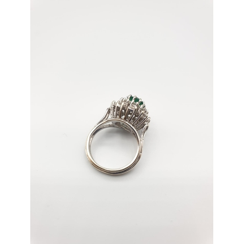 16 - 18ct gold ring with diamond and emerald, size J weight 6.7g...