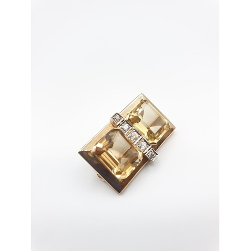 23 - 18ct gold diamond and citrine brooch, weight 7.2g ,consists of a row of 5 diamonds flanked by the ci...