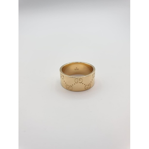 26 - 18CT GOLD 9MM GUCCI GOLD BAND .WEIGHT 11G SIZE Q....