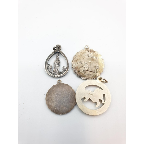 46 - Selection of 5 silver neck pendants to include 3 St Christopher medallion designs, 1 Aries and 1 Big...