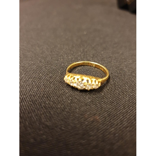 59 - A five stone diamond ring set in 18ct yellow gold, size J/K 3g...