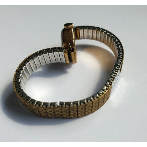 11 - Vintage 9ct gold 'Recons' ladies watch on a flex expandable strap in working order, weight 17.9g...