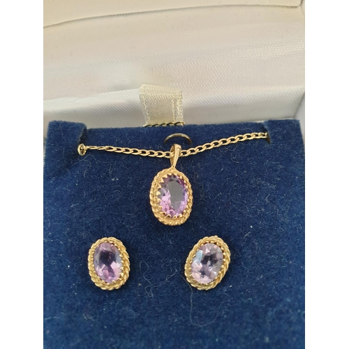 17 - 9ct gold and amethyst set to include an amethyst pendant with gold surround on a delicate gold chain...