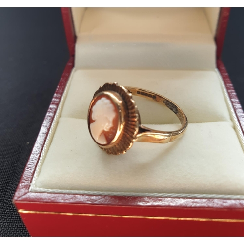 22 - 9ct gold Cameo ring, nice condition with ornate gold work surrounding the Cameo, weight approx 3.1g ...