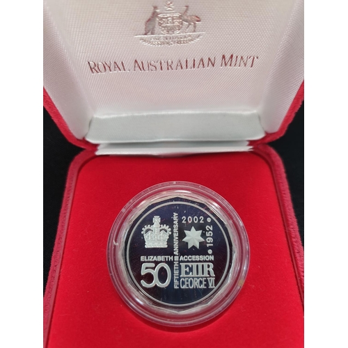 28 - Rare silver coin issued by the Royal Australian mint in 2002 to celebrate the 50th year of Queen Eli...