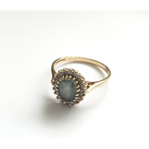 32 - Hallmarked 9ct gold ring with centre sapphire and a diamond surround, oval shaped (known as a Lady D...