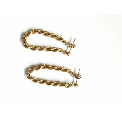 37 - Pair of 9ct gold twist drop earrings, approx 3cm drop and weight 1.8g...