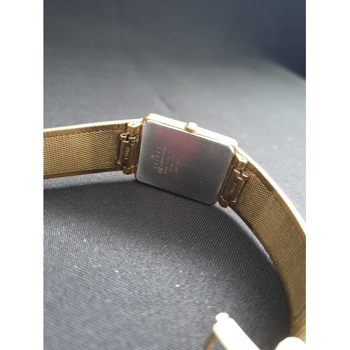 39 - Seiko gold plated mens watch with metal strap, black face and date box....