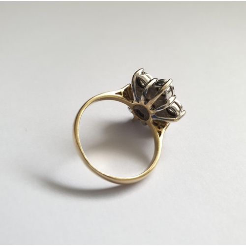 44 - 9ct gold ring with seven diamonds (0.5ct in total) forming a flower shape, weight approx 4.1g, size ...