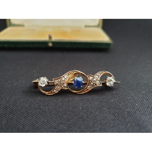 53 - Diamond and Sapphire bar brooch, 4cm length and consisting of 0.25ct diamond at each end and 14 smal...
