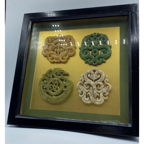 51 - Four Chinese Carved Hardstone Amulets (Late 19th to Early 20th Century) in a Presentation Frame....