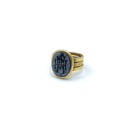 42 - An Unusual Vintage three band ring in 9ct Yellow and Rose Gold. The mount having an initialled seal....