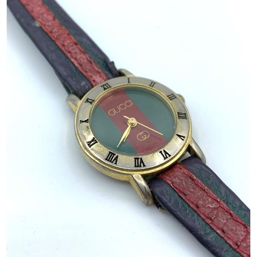 29 - Gucci Ladies Watch With Leather Strap....