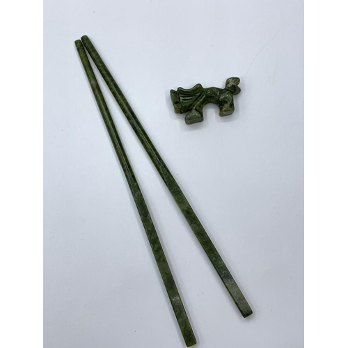 118 - A Chinese set of six pairs of carved jade chop sticks with assorted rests in the  shape of lions in ...