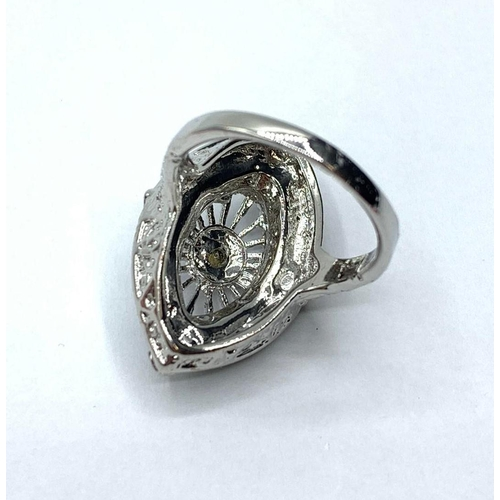 126 - An Art Deco silver (stamped 925) ring with green and white gems. Ring size: N