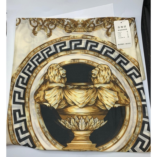 137 - A large Chinese silk scarf/shawl in the style of Versace. Unused in original bag. Dimensions: 180 x ...