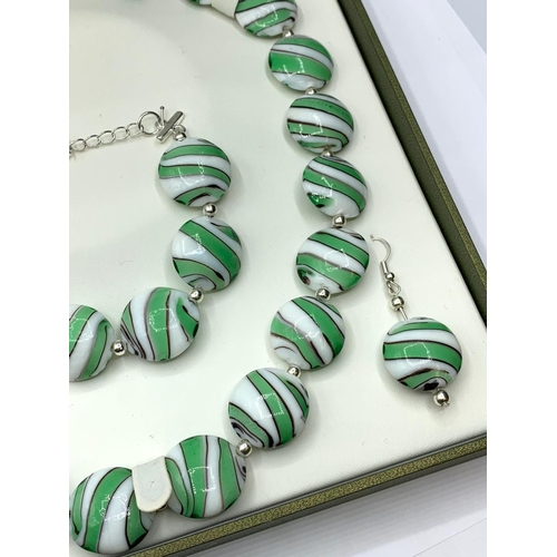 142 - A 60's style Murano handmade glass necklace, bracelet and earrings set in a presentation box. Neckla...