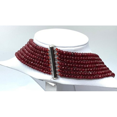 15 - An impressive seven row multi-faceted ruby necklace, Length 44-60cm Weight: 106 g. Rubies are colour...