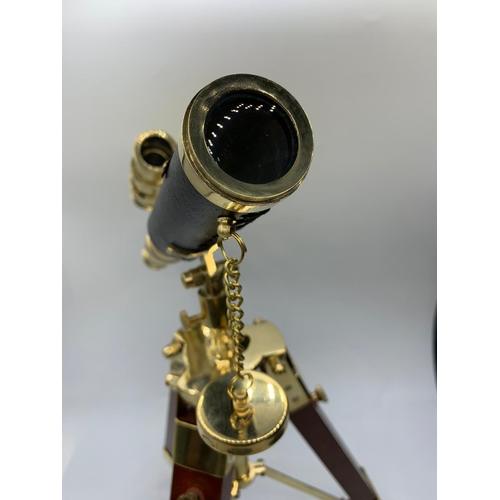28 - A highly ornamental, modern, brass, replica of an Edwardian telescope, on a mahogany and brass adjus...