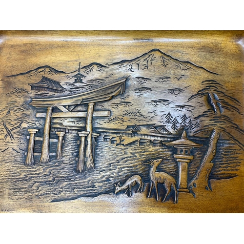 38 - A wooden tray with relief carving of Itsukushima Shinto Shrine in Japan.             It depicts the ...