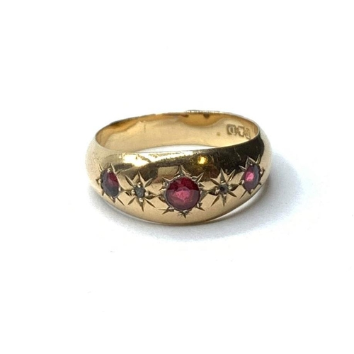 104 - 18ct gold RING with 3 Ruby stones.  2.2 g.  size K.