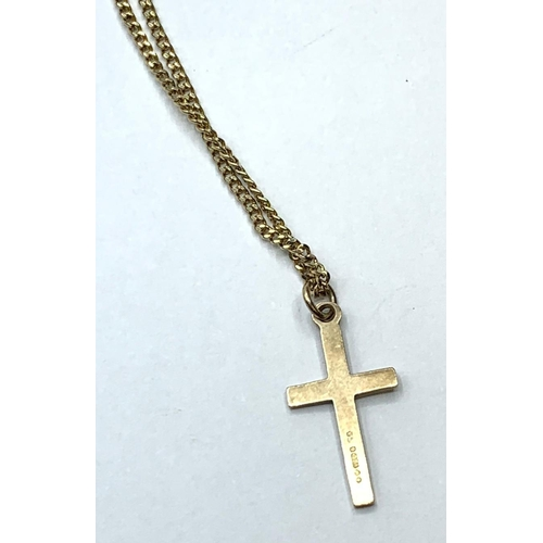 143 - 9ct small gold CROSS on a rolled gold chain.