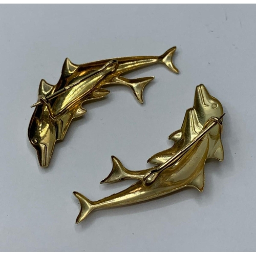 289 - A pair of 9ct dolphin brooches