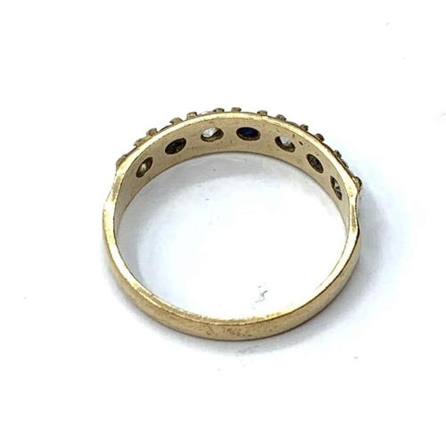 379 - 9ct RING with 7 stones. 1.4g  Size K