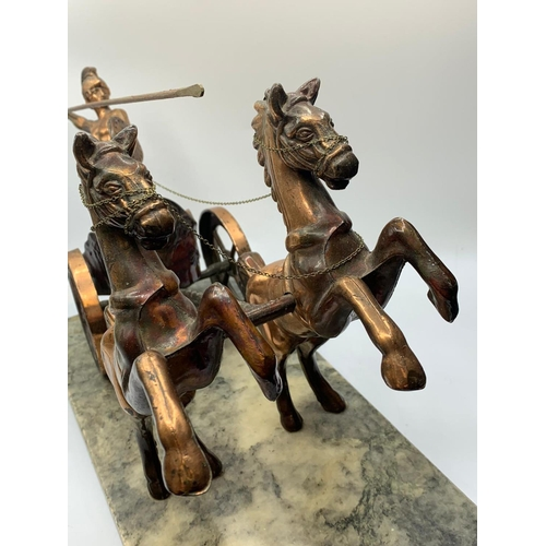 491 - Horsedrawn CHARIOT with warrior on marble base.  35cm x 15cm