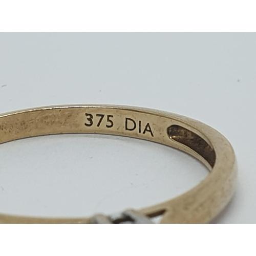 260 - 9ct diamond ring, weight 1.2g, size M