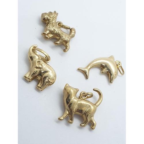298 - 4 x 9ct gold PENDANTS/CHARMS .  2.5g