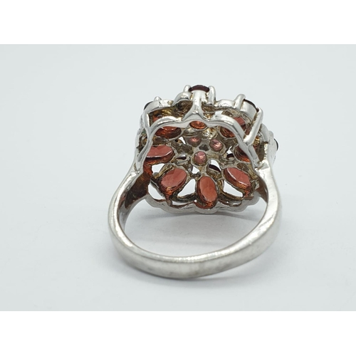 383 - 2 large silver dress rings, weight 21.5g
