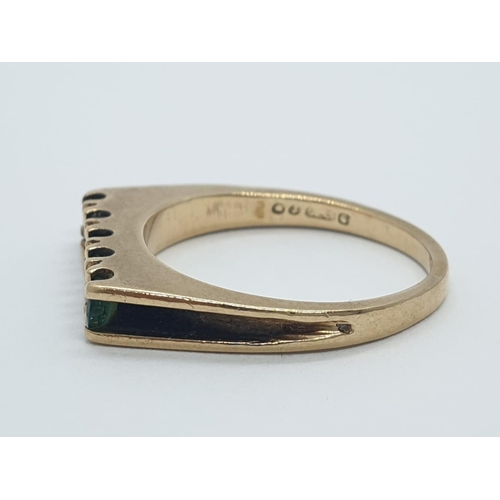 395 - 9ct gold RING with green stones.  Size O