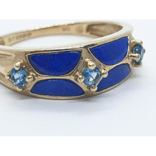 398 - 9ct gold enamel and topaz RING.  2.3g   Size K
