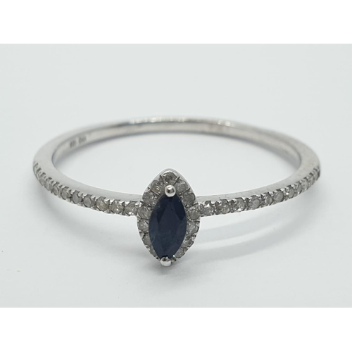 401 - Sapphire and diamond silver RING.  1.3g   Size U