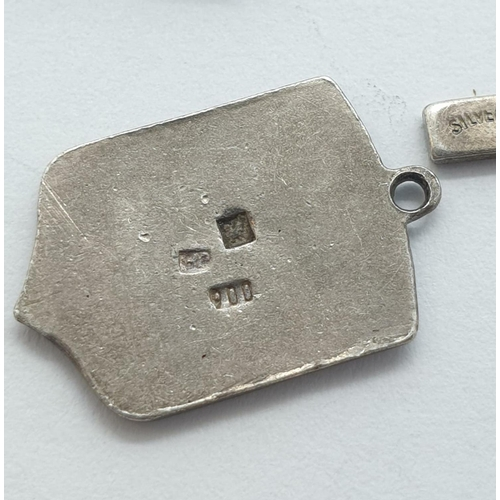 581 - 4 x silver CHARMS.   11.8g
