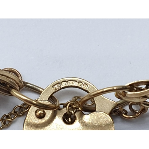 140 - 9ct gate BRACELET with heart padlock.  4.9g. 16cm.