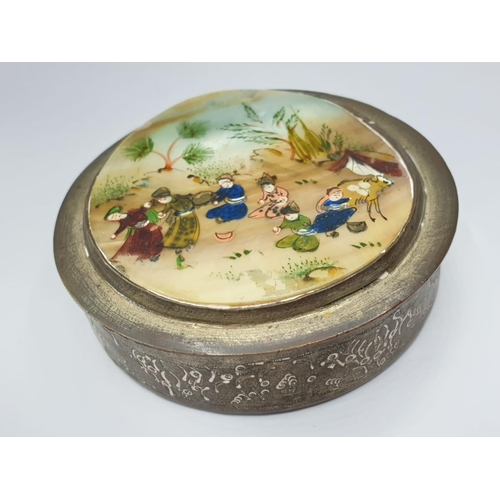 189 - An early Oriental COMPACT with enamelled lid.  Diameter 6.5cm.