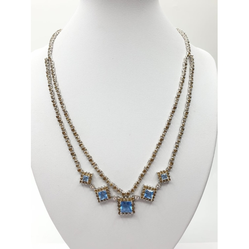 392 - 44cm silver NECKLACE with blue stones.  32.1g