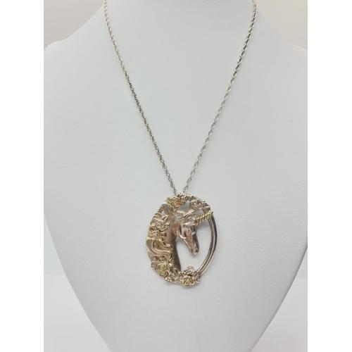 493 - Silver unicorn PENDANT on 60cm silver chain. 17.6g.  Pendant is 4cm long.