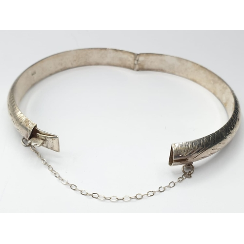 501 - Silver BANGLE with safety chain.  11.8g