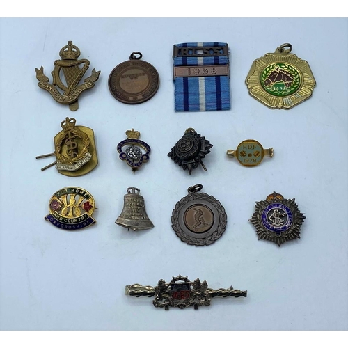 209 - 12 assorted badges and medals