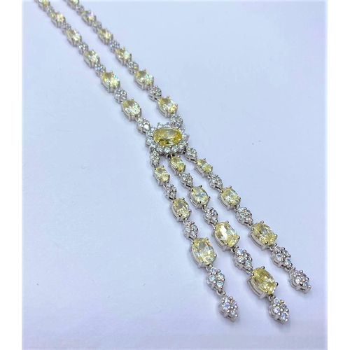 231 - Silver heavy NECKLACE with white and yellow stones.  45.78g     40cm.